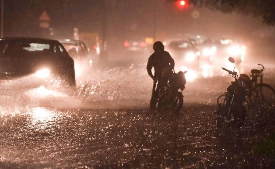 Commuters braving the heavy rain that lashed Chandigarh on Tuesday night.