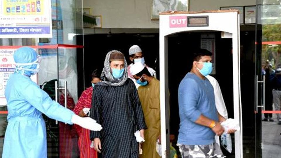 Coronavirus positive patients being discharged from a hospital after their treatment of Covid-19 disease in Bhopal.