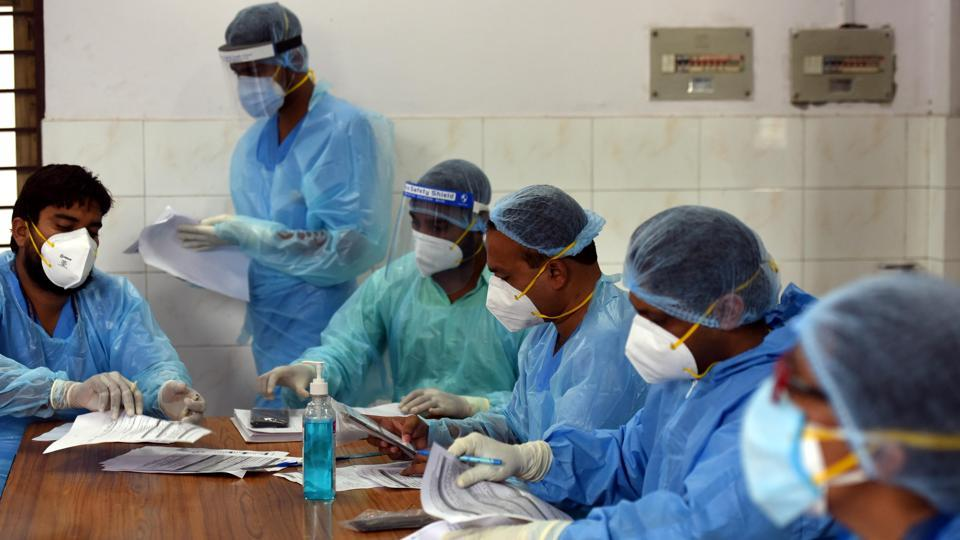Medics at work in a Covid-19 Testing Centre at the Rajiv Gandhi Super Specialty Hospital in New Delhi on July 6. Delhi on July 6 recorded 1,379 new Covid-19 cases, its lowest daily increase since June 9 but enough to take the capital's total case count to a grim 100,823 with 3,115 lives lost as of last count. (Sonu Mehta / HT Photo)
