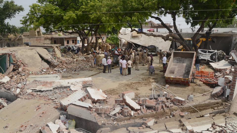 Kanpur: Debris lie on the ground following the demolition of the residence of criminal Vikas Dubey, after an encounter in Bikaru village where 8 police personnel lost their lives, in Kanpur.