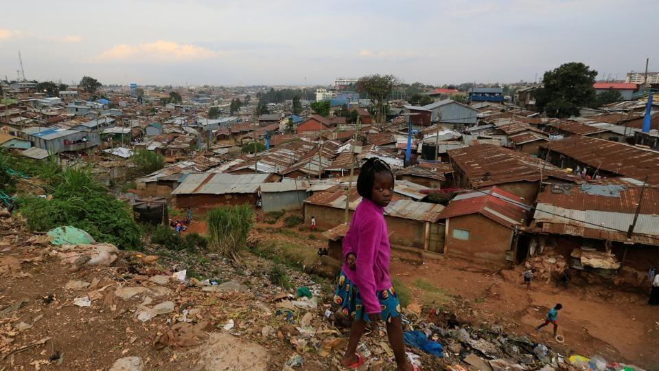 A child is seen at a domestic dumpsite, amid the spread of the coronavirus disease (Covid-19) within Kibera slums in Nairobi, Kenya.