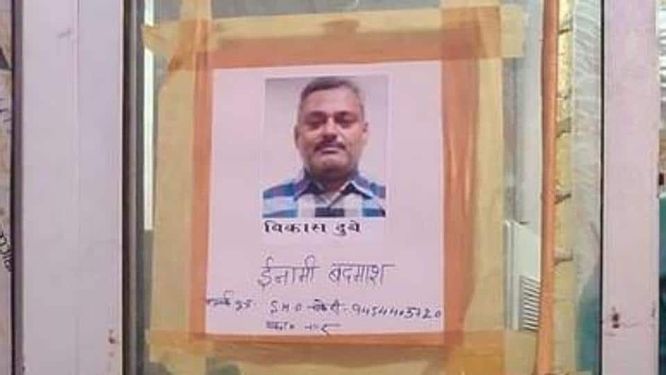 Posters seeking information about criminal Vikas Dubey, on the run since last Friday. (ANI photo)