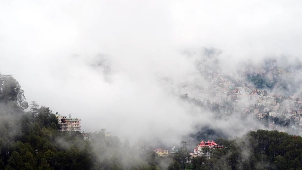 Clouds hovering over Shimla town after rain on Wednesday.