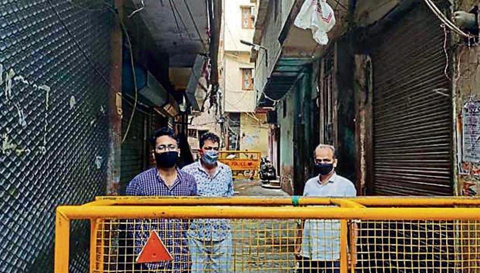 Residents of Gali Chhatta Lal Miyan in the sealed lane.