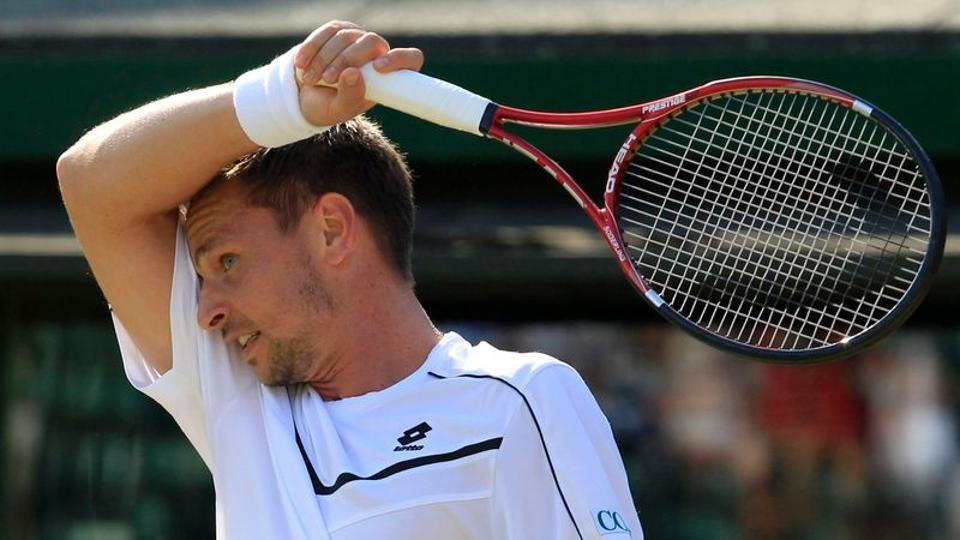 Robin Soderling wipes his forehead during his match against Bernard Tomic.