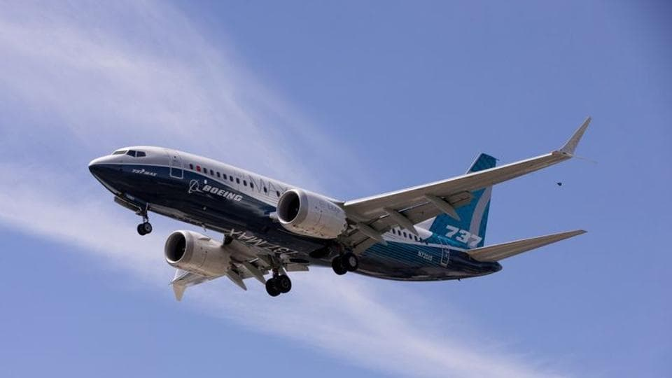 A Boeing 737 MAX airplane lands after a test flight at Boeing Field in Seattle, Washington, US.