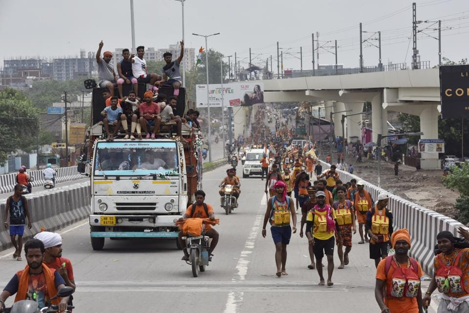 Kanwariyas carrying water from the Ganga River during the Kanwar Yatra ahead of Shivratri Festival, seen at GT Road near Dilshad Garden, in New Delhi.