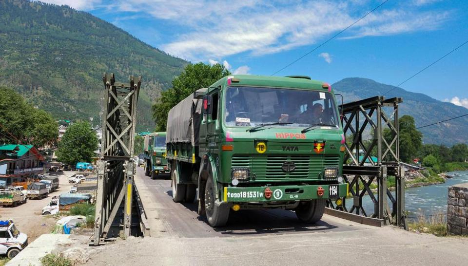Indian army trucks depart towards Ladakh amid stand off between Indian and Chinese troops in eastern Ladakh, at Manali-Leh highway in Kullu district, Monday, July 6, 2020.