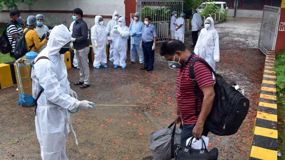 Medical staff sanitize the belongings of patients who recovered from Covid-19 and are being discharged from the hospital in Dhanbad on Sunday.