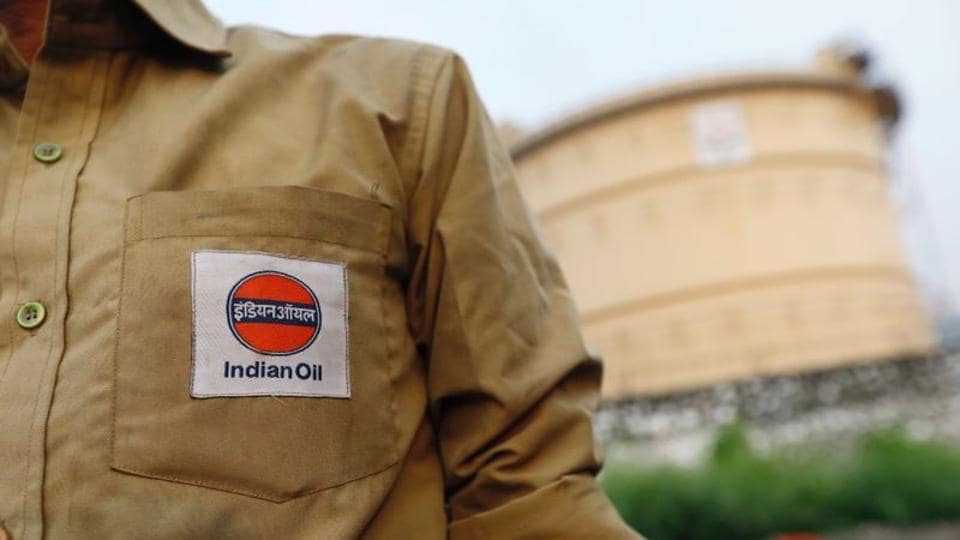 An Indian Oil tanker driver waits outside a fuel depot in Mumbai, India.