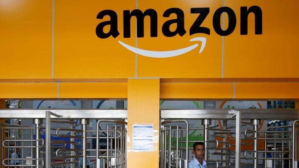 An employee of Amazon walks through a turnstile gate inside an Amazon Fulfillment Centre (BLR7) on the outskirts of Bengaluru.