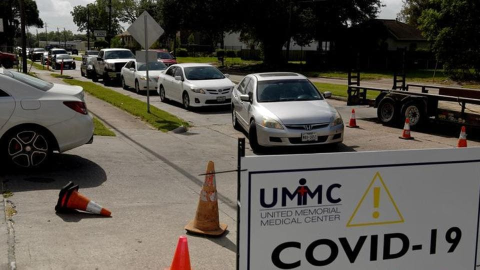 People wait in their vehicles in long lines for the coronavirus disease (COVID-19) testing in Houston, Texas, US.