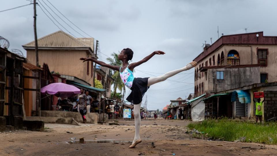 Precious Duru, a student of the Leap of Dance Academy, performs a dance routine in the Ajangbadi neighbourhood of the Nigerian capital Lagos on July 3. Up until a few years ago, pirouettes and arabesques were unheard of in this neighbourhood in the sprawling megacity. That is, until a ballet aficionado brought the dance form here by opening a school for local students. (Benson Ibeabuchi / AFP)