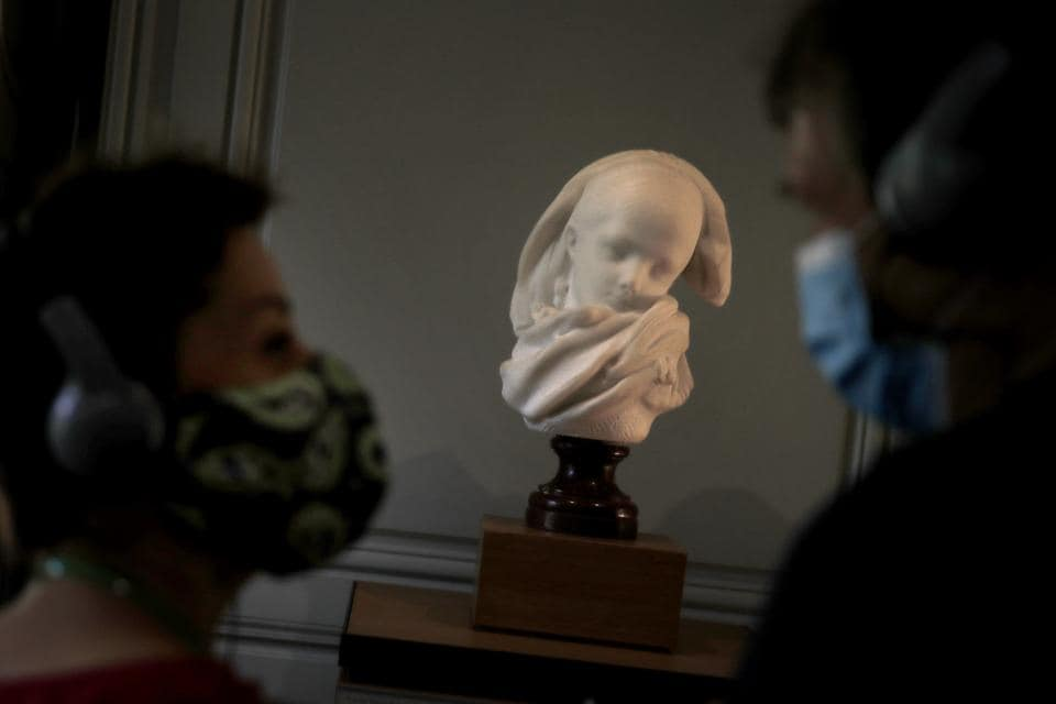 Visitor watch l'Orpheline Alsacienne by French sculptor Auguste Rodin in Paris Tuesday, July 7, 2020.  (AP)