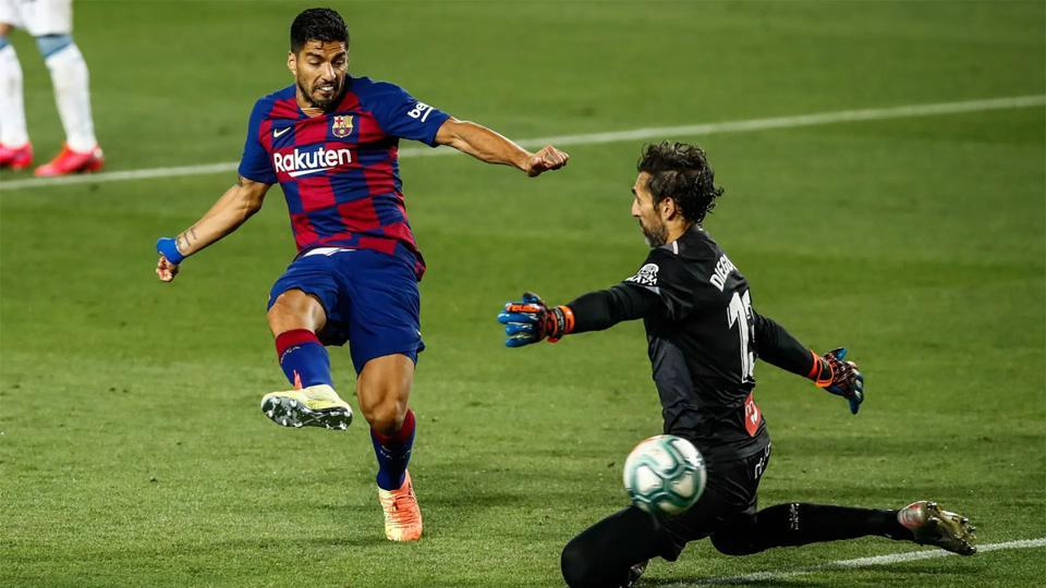 Luis Suarez beats the Espanyol goalkeeper, Diego Lopez, in the second half at the Camp Nou.