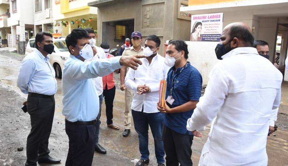 District collector Naval Kishore Ram (in sky blue shirt) visited Gujar-Nimbalkarwadi on Wednesday.