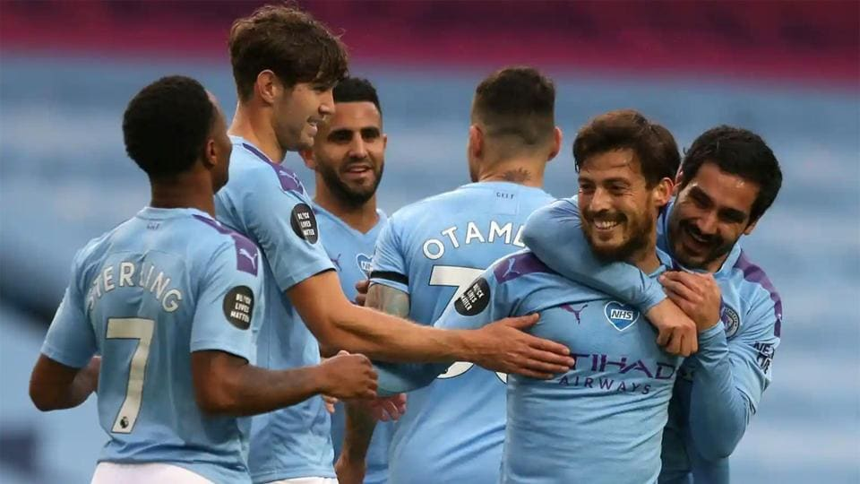 David Silva of Manchester City (second right) celebrates after he scores his side's fourth goal.