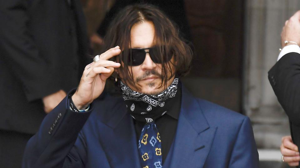 Johnny Depp arrives at the High Court in London, Thursday, July 9, 2020.