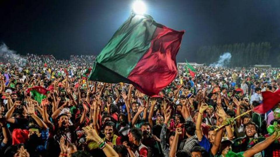 Mohun Bagan supporters celebrate after they defeated Calcutta Customs by 2-0 to lift the Calcutta Football league trophy, in Kolkata, Wednesday, Sept 12, 2018.