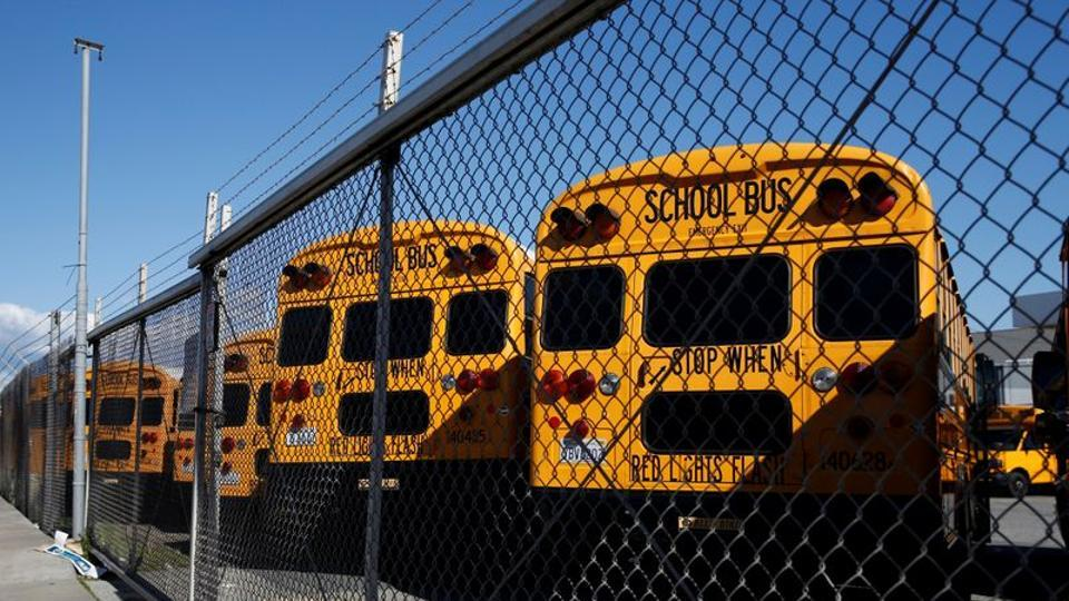 School buses are seen parked at First Student Charter Bus Rental as the spread of coronavirus disease continues in San Francisco, California, US.