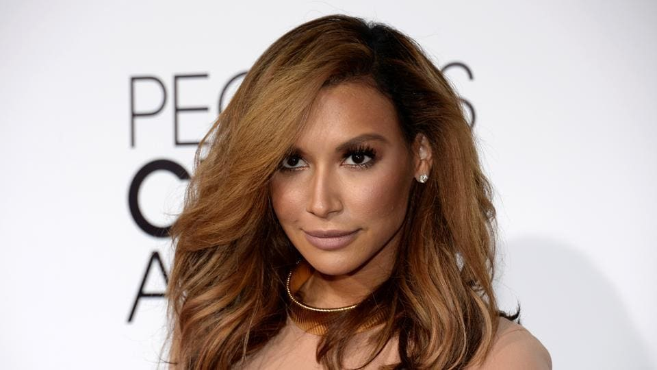 Naya Rivera, from the Fox series Glee, arrives at the 2014 People's Choice Awards in Los Angeles.