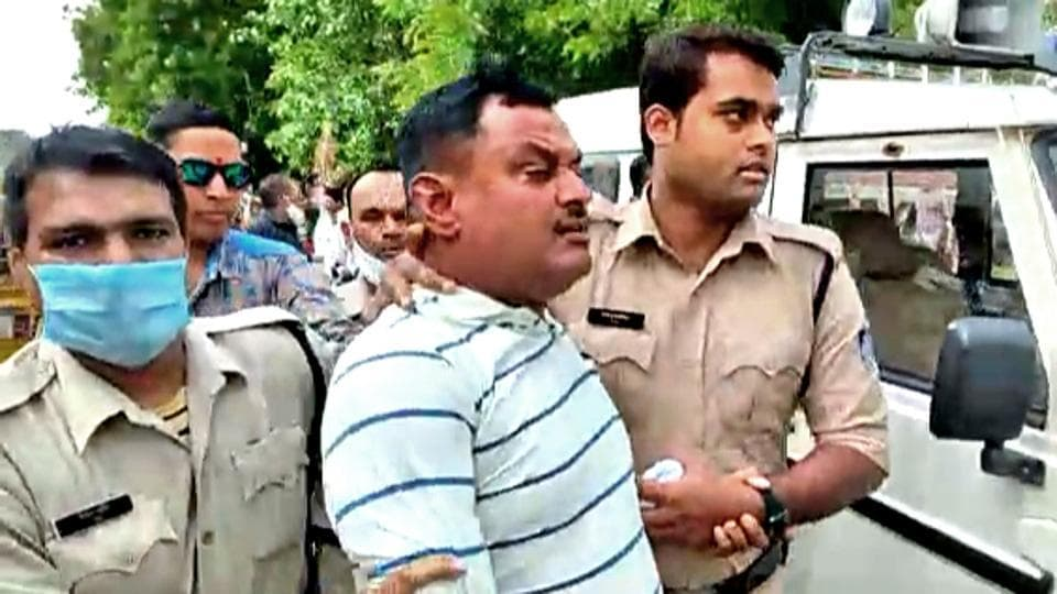Vikas Dubey, the main accused in the massacre of eight policemen in Kanpur on July 3,  after his arrest in Ujjain on Thursday