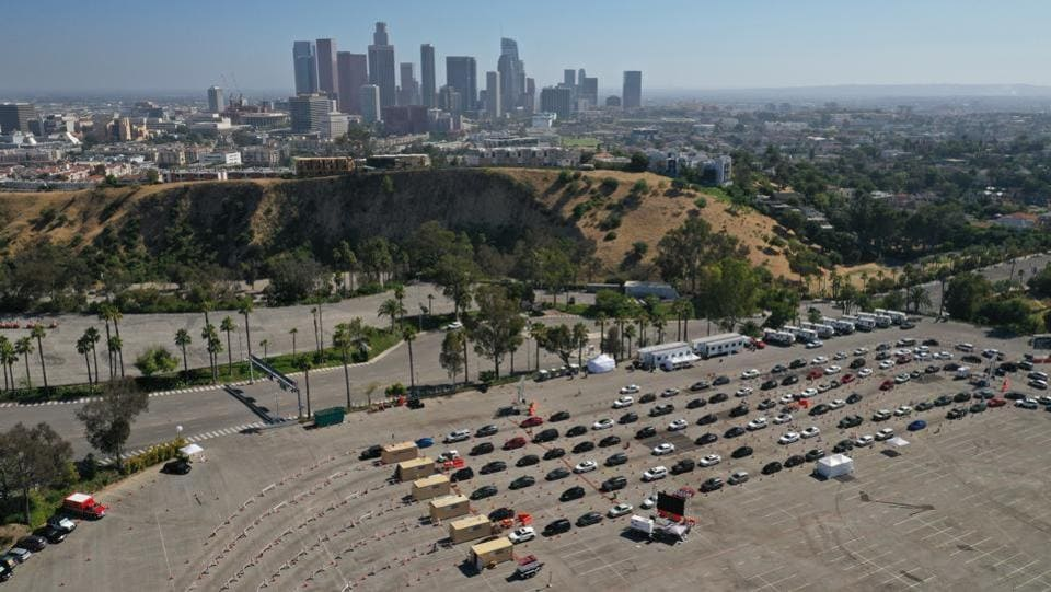 An aerial view of cars lined up at a Covid-19 drive-thru testing site at the parking lot of Dodger Stadium in Los Angeles on July 7. According to a report by HT, on July 8 the number of confirmed infections went up by a record single-day spike of 60,021 to 3,009,611 and the fatalities climbed by 1,195 to 131,594. (Bing Guan / Bloomberg)