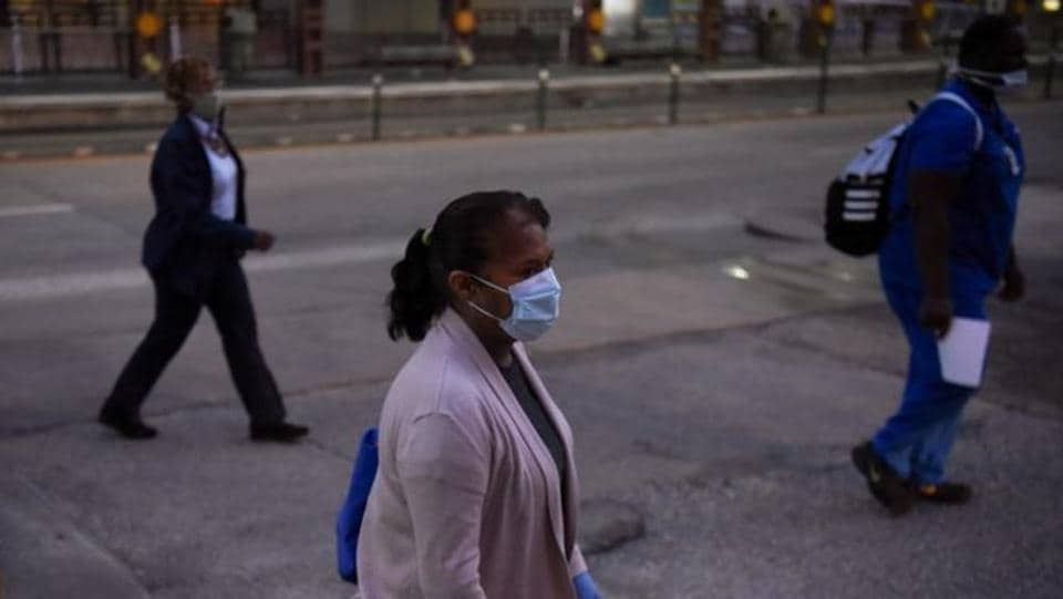 Health workers walk through the Texas Medical Centre during a shift change as cases of the coronavirus spike in Houston, Texas on July 8. The Texas state fair, which had been scheduled to open on September 25, has been cancelled for the first time since World War Two, organizers announced on July 7. (Callaghan O'Hare / REUTERS)