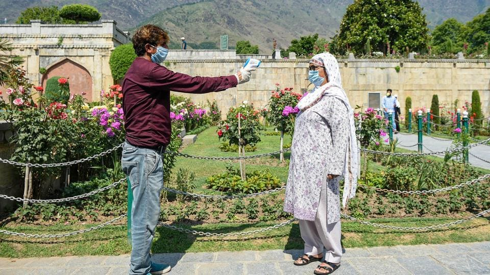 Srinagar: A visitor undergoes thermal screening at the entrance of Mughal garden after the authorities decided to reopen it for tourists, during Unlock 2.0, in Srinagar, Wednesday, July 8, 2020.  (PTI)