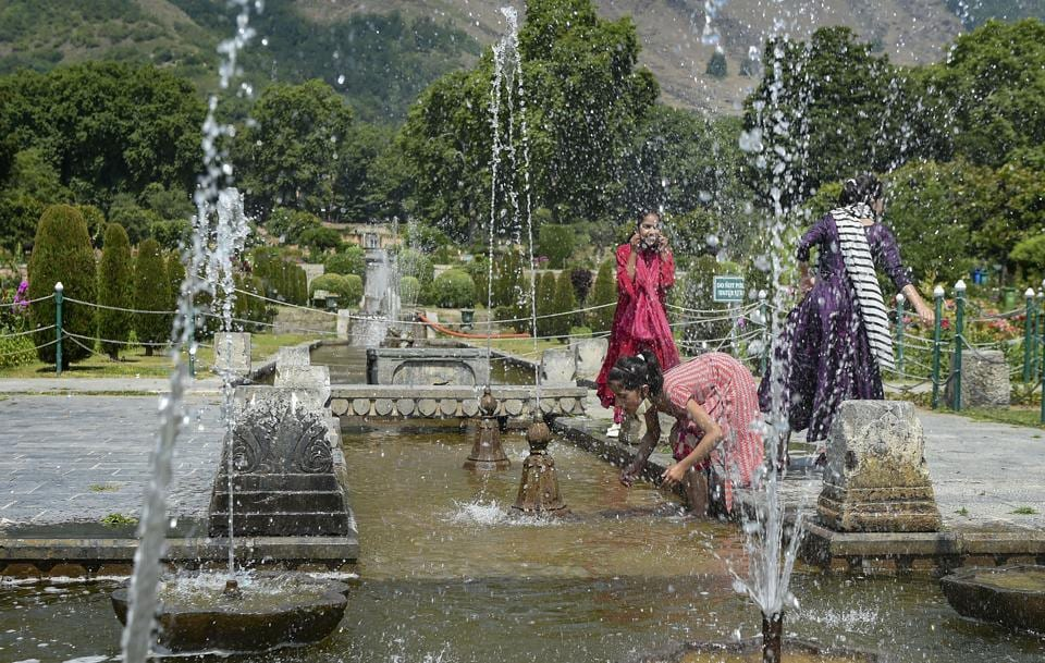 Srinagar: Girls play at Mughal garden after the authorities decided to reopen it for tourists, during Unlock 2.0, in Srinagar, Wednesday, July 8, 2020.  (PTI)