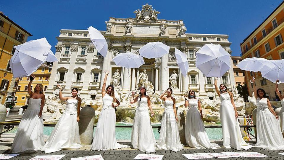 Women hold a protest by the Trevi fountain in Rome against the postponement of their weddings due to strict curbs on ceremonies amid the coronavirus pandemic.