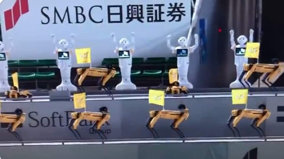 The image shows two different types of robots cheering for the team.