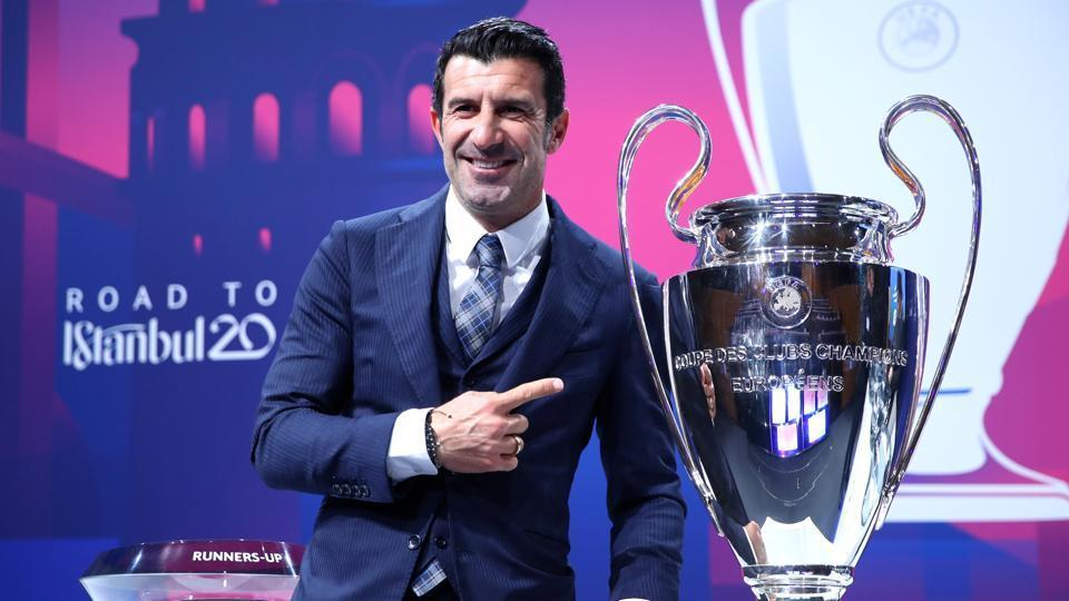 Luis Figo poses with the trophy before the draw.