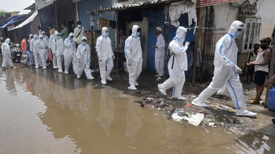 Health workers wearing PPE coveralls arrive to conduct door-to-door screenings for residents of Malad (West) in Mumbai on July 7. The government of India has said that the country has one of the lowest deaths in the world with deaths per million population at 15.31 which translates to a fatality rate of 2.75%—the global deaths per million population stands at 68.7, reported HT. (Satyabrata Tripathy / HT Photo)