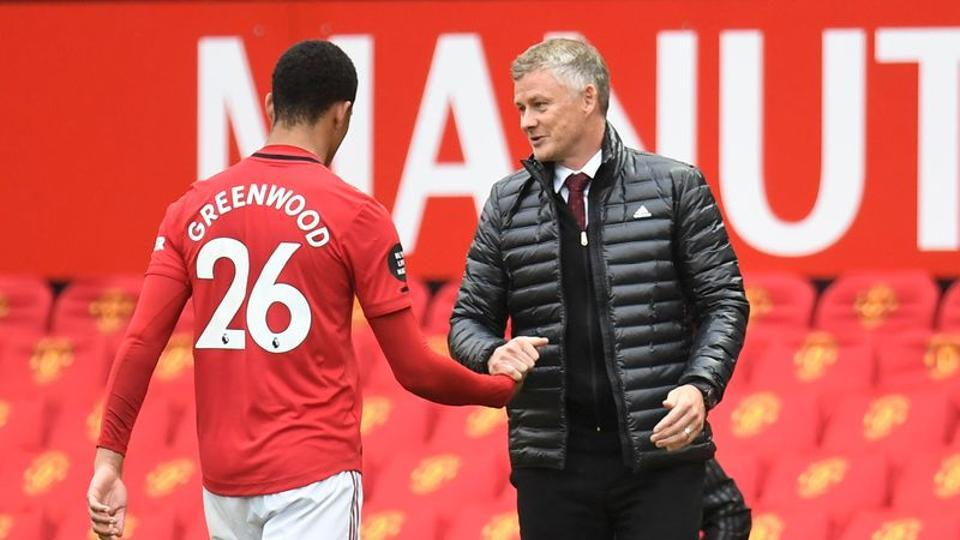 FILE PHOTO: Premier League - Manchester United v AFC Bournemouth - Old Trafford, Manchester, Britain - July 4, 2020 Manchester United manager Ole Gunnar Solskjaer substitutes off Manchester United's Mason Greenwood, as play resumes behind closed doors following the outbreak of the coronavirus disease (COVID-19) Peter Powell/Pool via REUTERS
