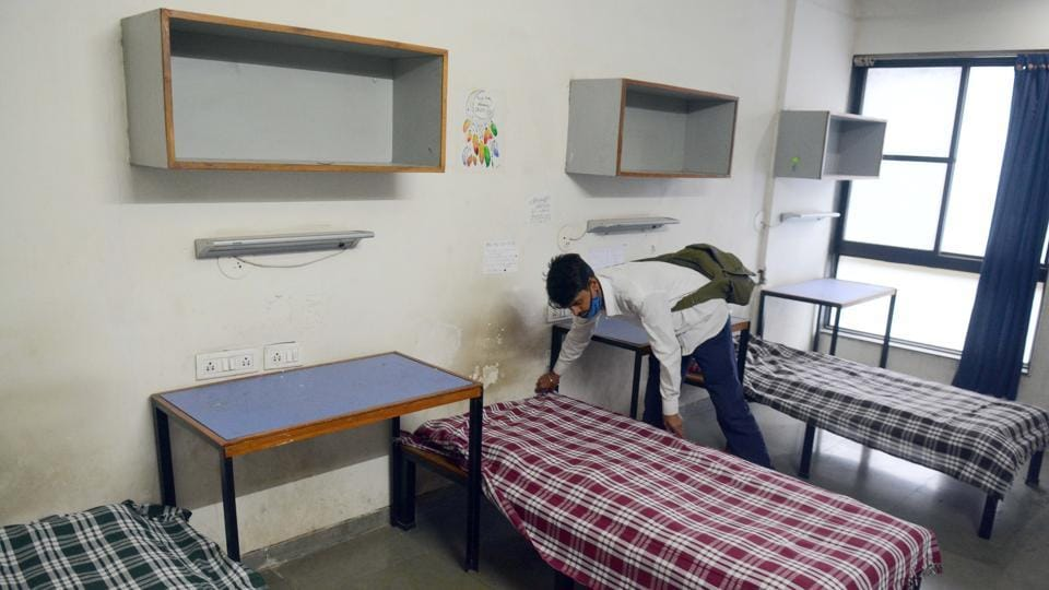 A worker makes beds for Covid-19 patients at COEP students' hostel, which is temporarily turned into a quarantine facility in Pune on July 9. On July 9, the number of recovered cases had overshot the number of active cases by 206,588. Total recovered cases are almost twice the number of active cases now. (Shankar Narayan / HT Photo)