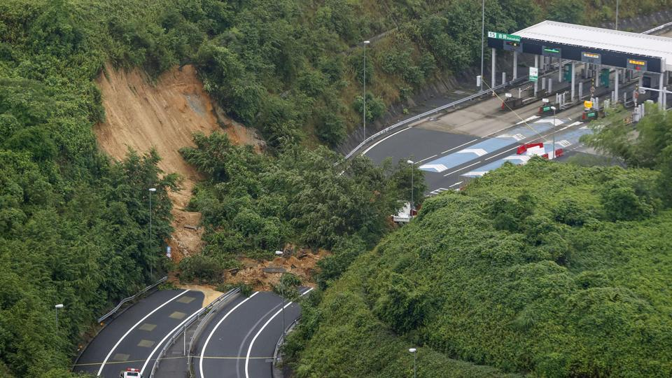 A landslide is seen near an exit of a highway in Kyoto on July 9. Japan's Fire and Disaster Management Agency told AFP that rising floodwater or roads damaged by landslides had blocked access to more than 3,000 households, mostly in the hardest-hit southwestern region of Kumamoto where fresh downpours were forecast. (Kyodo News / AP)