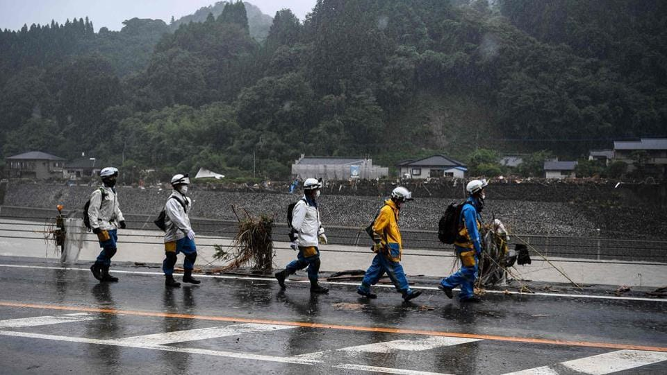 Police arrives to help in rescue and clean up operations in Kuma village on July 9. Japan Meteorological Agency (JMA) issued its second-highest evacuation order to more than 450,000 people. However, such orders are not compulsory and most residents are choosing not to go to shelters, possibly due to coronavirus fears.  (CHARLY TRIBALLEAU / AFP)