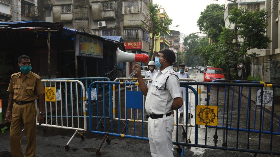 A Kolkata Police personnel speaks on the loudspeaker at Kankurgachi -- one of the new coronavirus containment zone in Kolkata, West Bengal on Thursday.
