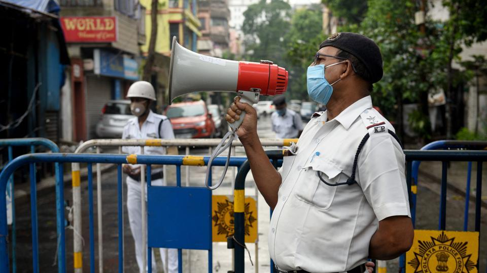A Kolkata Police personnel speaks on the loudspeaker, alerting people to not step out of their homes in Kankurgachi – one of the new Covid-19 containment zones in Kolkata, on July 9. In the highest jump so far, India recorded 26,506 new cases of the coronavirus disease (Covid-19) between July 9 and July 10 morning, pushing its infection tally to 793,802, according to the Union health ministry. (Samir Jana / HT Photo)
