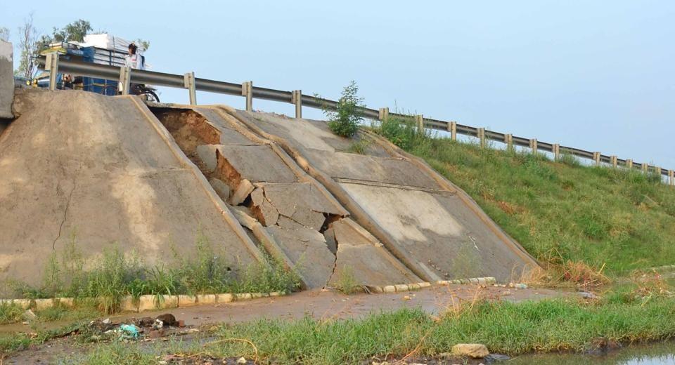 The damaged sidewall of Sherpur bridge in Ludhiana on Friday.