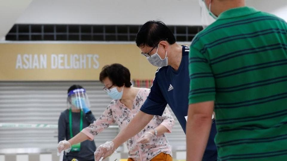 Voters cast their ballots at a polling station, during a time band allocated to seniors and elders as part of preventive measures against the coronavirus disease (COVID-19) outbreak, in Singapore July 10.
