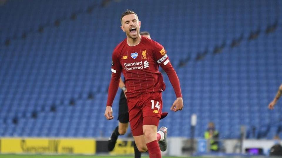 Liverpool's Jordan Henderson celebrates scoring their second goal, as play resumes behind closed doors following the outbreak of the coronavirus disease (COVID-19) Daniel Leal Olivas/Pool via REUTERS
