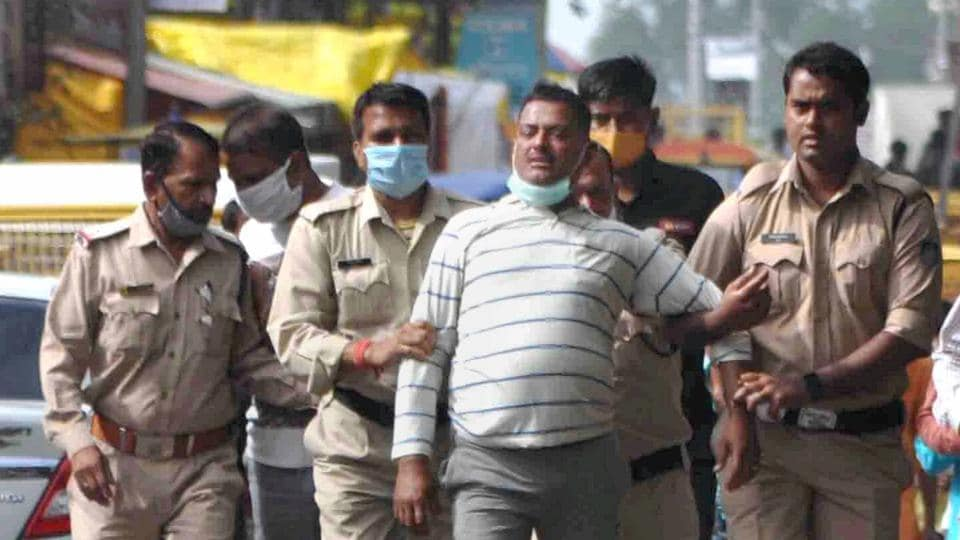 Ujjain: Notorious gangster Vikas Dubey, the main accused in killing of eight policemen in the Kanpur encounter recently, being apprehended by police personnel after a nearly week-long manhunt, in Ujjain.