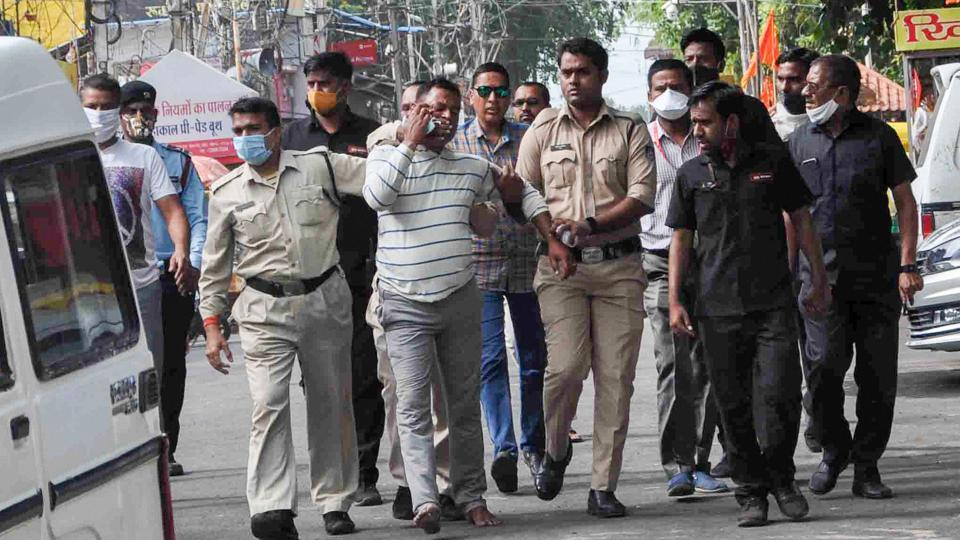 Gangster Vikas Dubey was  apprehended by police personnel after a nearly week-long manhunt, in Ujjain on Thursday.