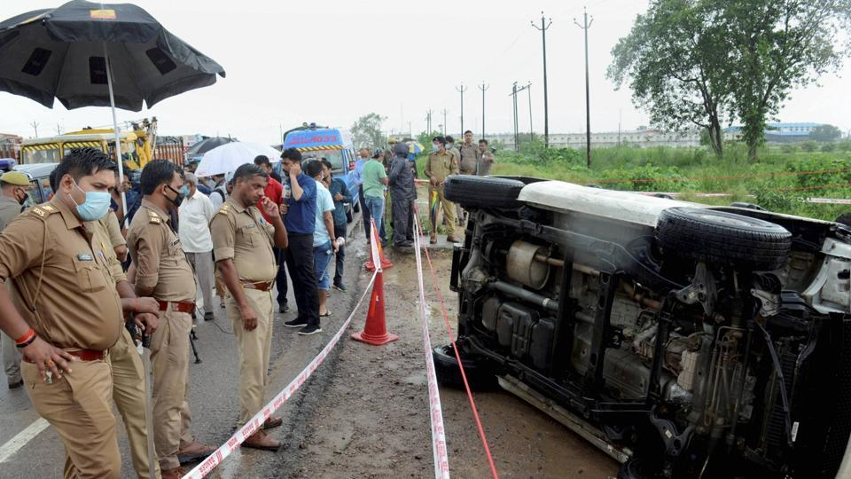 Police inspect the encounter site where gangster Vikas Dubey was killed when he allegedly tried to escape from the spot following an accident, near Kanpur.