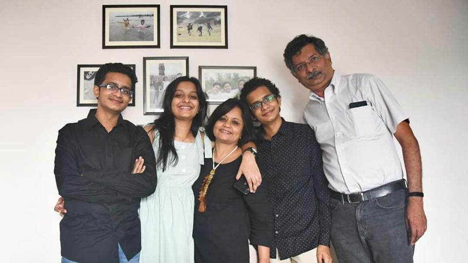 Harsh, Khushi and Anand Doshi with their parents.
