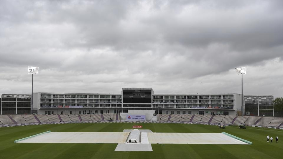 The covers are on as rain delays play on the first day of the 1st cricket Test match between England and West Indies, at the Ageas Bowl in Southampton, England, Wednesday July 8, 2020. (Mike Hewitt/Pool via AP) (AP)