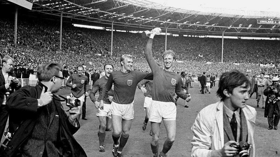FILE - In this July 30, 1966 file photo England's Jack Charlton, right, holds the Jules Rimet trophy aloft as he parades it around Wembley with teammate Bobby Moore following their 4-2 win over West Germany. England World Cup winner Jack Charlton has died aged 85 it was announced on Saturday July 11, 2020. (PA via AP)