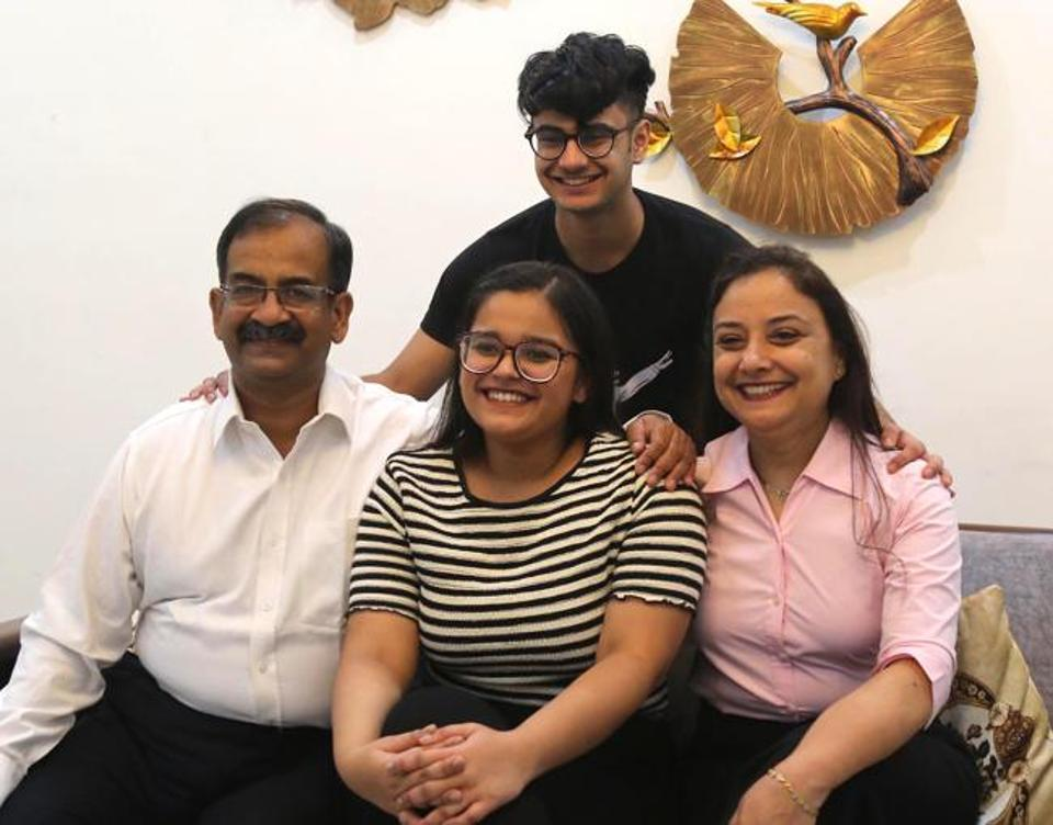 Muskan Saxena, who topped among Chandigarh, Mohali and Panchkula, with 99.25% marks, with her family at PGIMER, Chandigarh, on Friday.